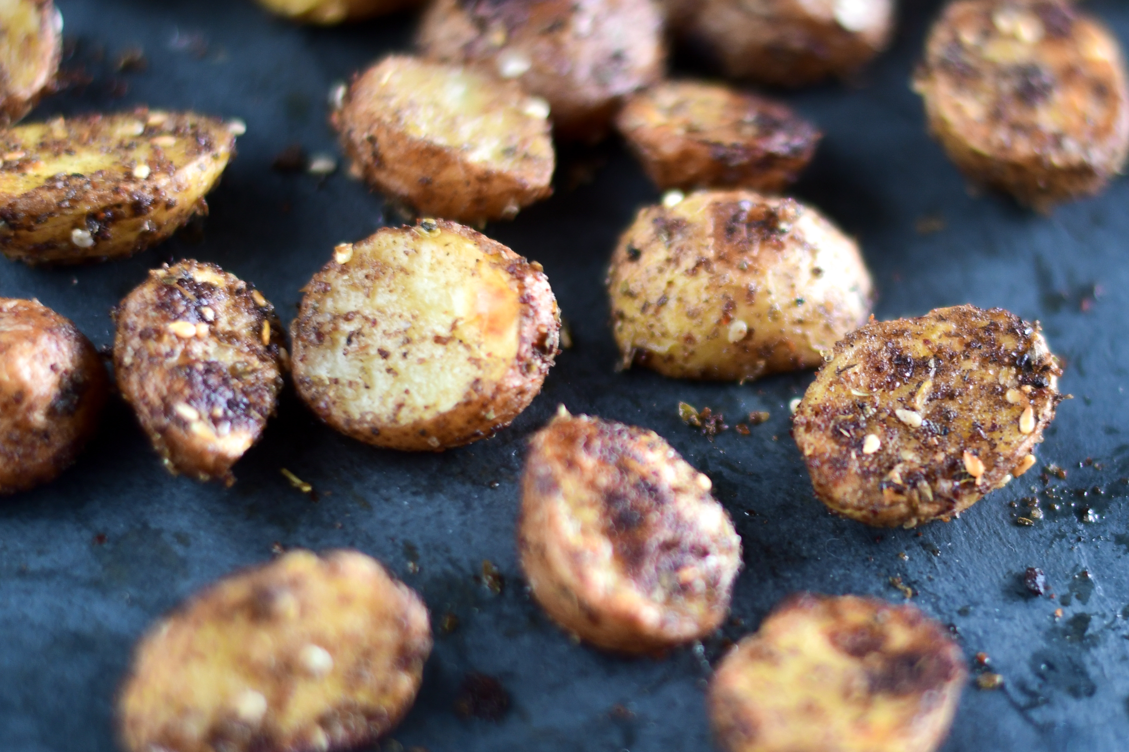 Switch up classic roasted potatoes with these Roasted Za'atar Potatoes instead! It's the perfect accompaniment to any Middle Eastern dinner!
