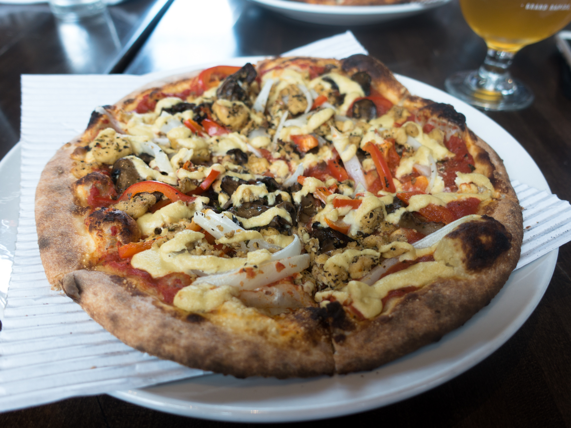 Whether you live in Grand Rapids or our planning a trip to this great Midwest city, I hope that this list of the Best Places for Vegan Pizza In Grand Rapids is helpful in your quest to find delicious vegan pizza! #vegan #pizza #travel #grandrapids