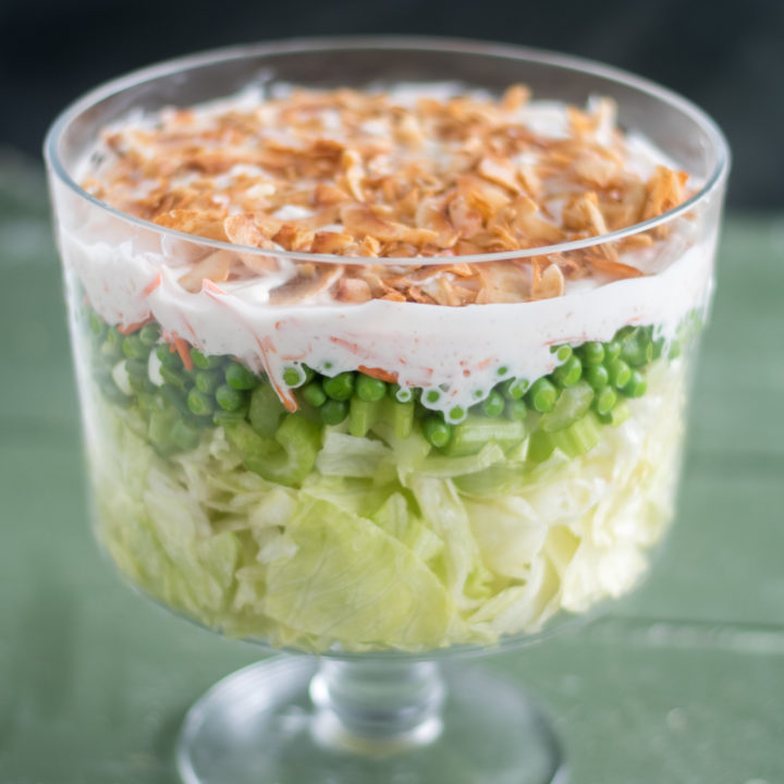 Vegan 7 Layer Salad is an updated version of a traditional Midwest layered salad. It is even better the next day! #Vegan #salad #Christmas #holiday #potluck