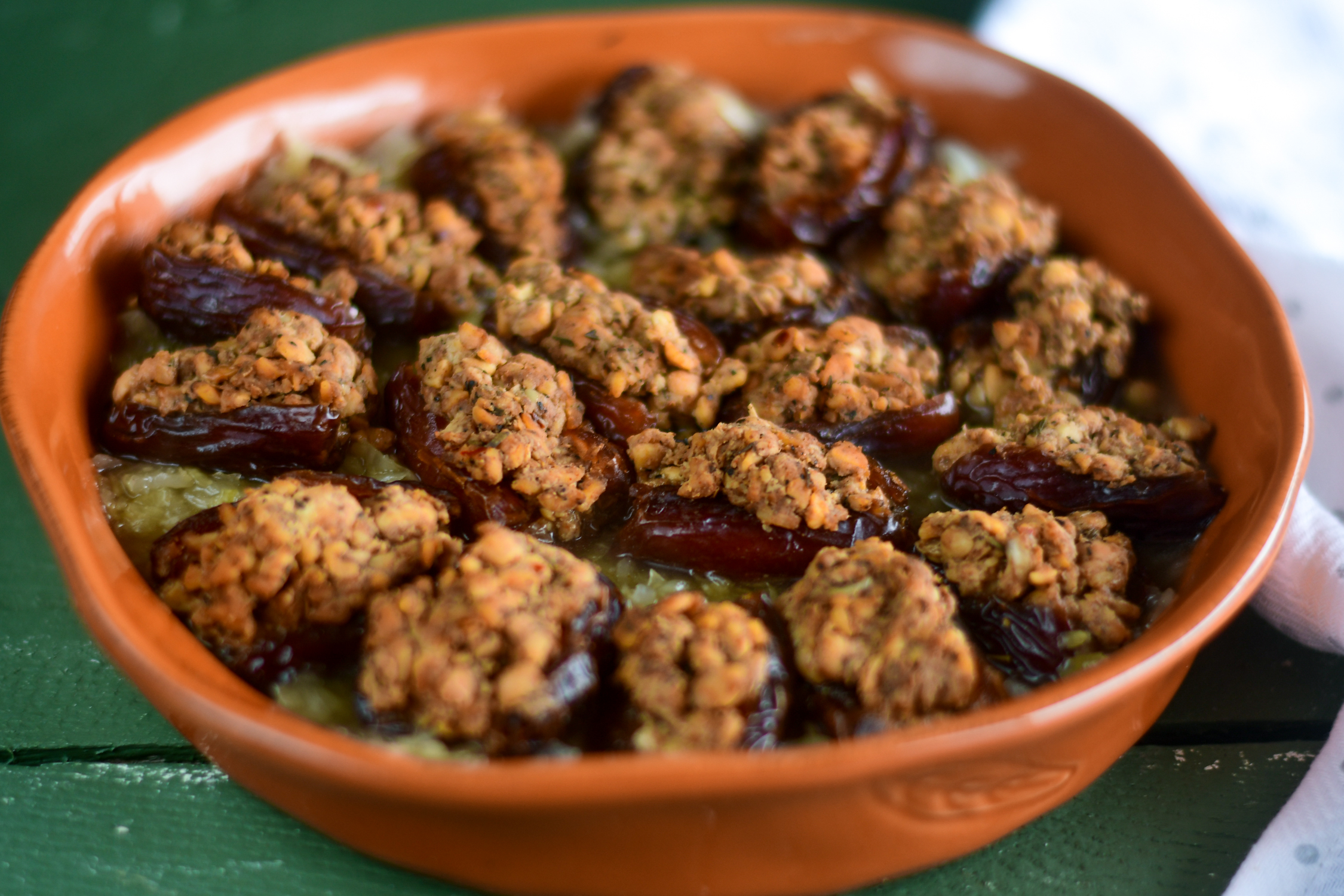 Vegan Sausage Stuffed Dates served with sauerkraut.