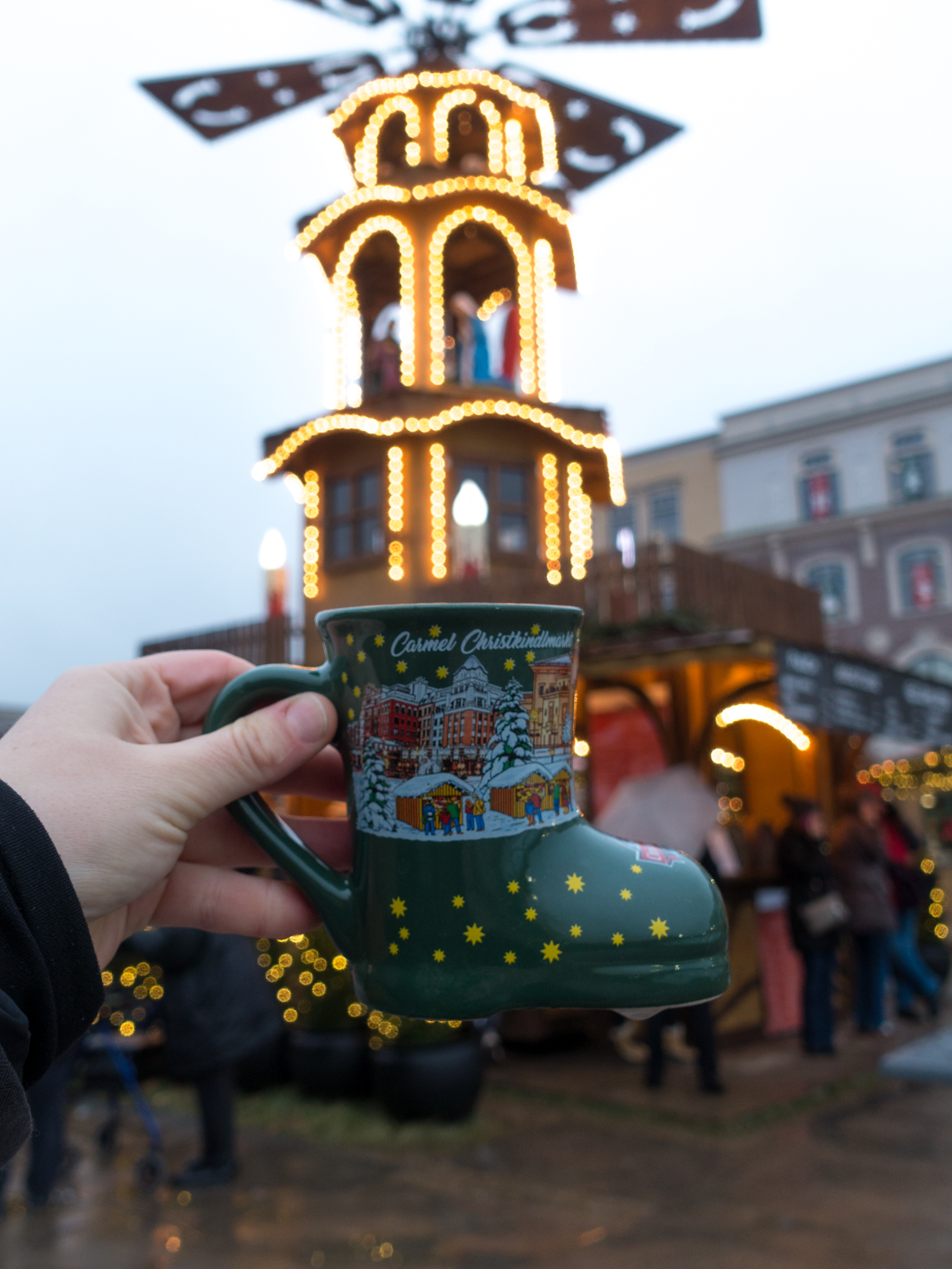 While strolling around the Christmas market, enjoy a mug of Gluhwein—a traditional hot mulled wine. #Christmas #travel #wine #holiday #Indiana