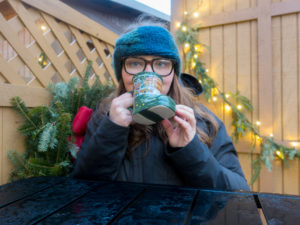 While strolling around the Christmas market, enjoy a mug of Gluhwein—a traditional hot mulled wine. #travel #wine #Indiana