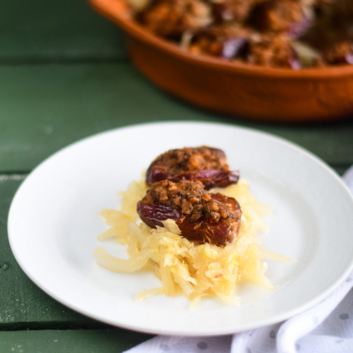 Vegan Sausage Stuffed Dates with sauerkraut are a sweet and savory appetizer perfect for entertaining! #Christmas #Vegan #Recipes #holiday