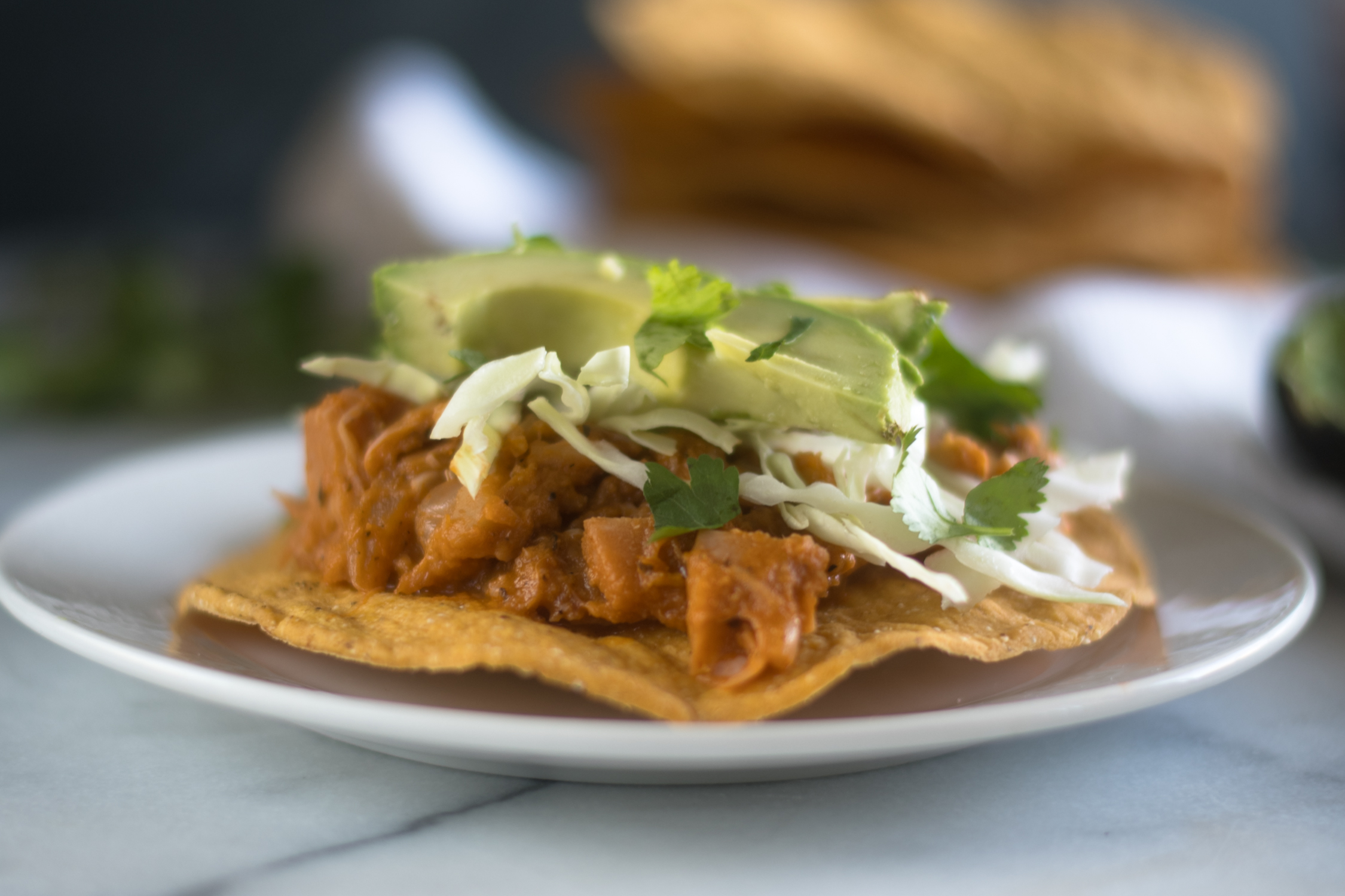 Vegan tostadas topped with jackfruit.