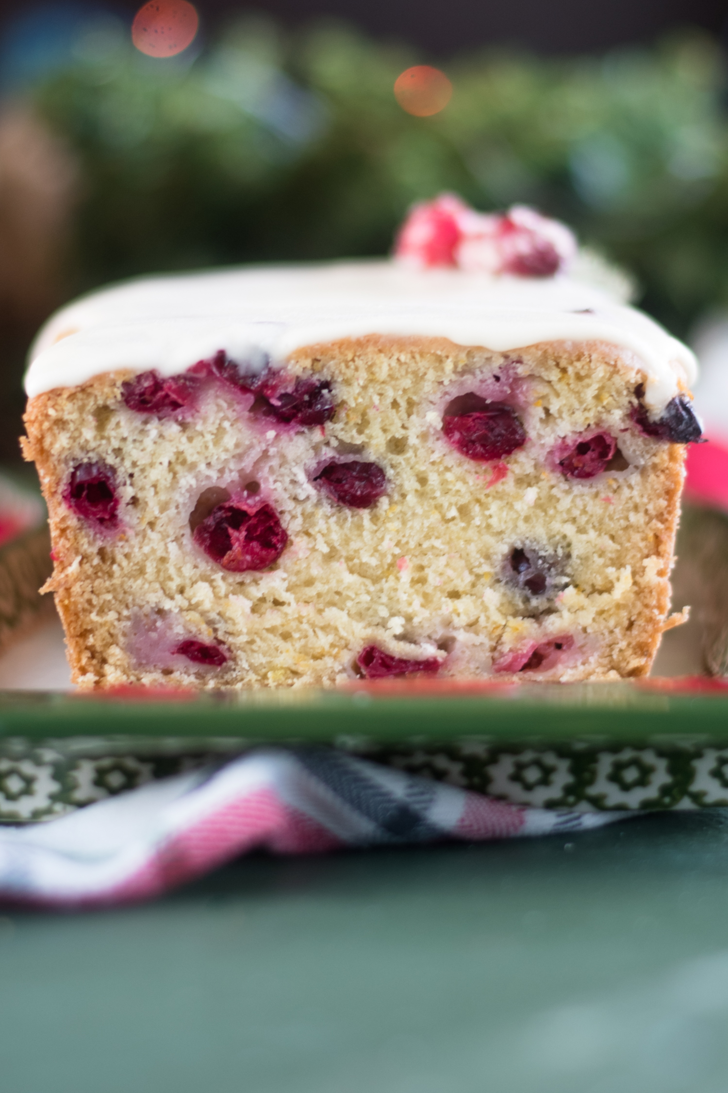 This Vegan Cranberry Orange Pound Cake would be perfect for serving on Christmas! Your family will just love this pound cake. #vegan #dessert #Christmas #holiday #recipes