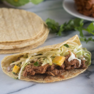 Switch of taco night with these BBQ Jackfruit Tacos with Avocado Mango Cabbage Slaw!