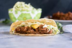 Switch of taco night with these BBQ Jackfruit Tacos with Avocado Mango Cabbage Slaw!