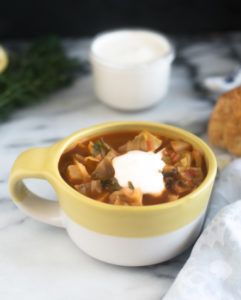 ThisPotato and Cabbage Soup is a hearty vegan soup recipe that is perfect for the colder months. #soup #vegan #recipe #winter #healthy #healthyrecipes