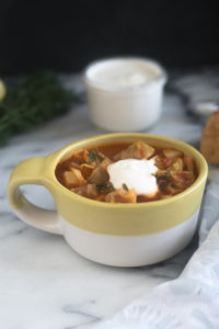 ThisPotato and Cabbage Soup is a hearty vegan soup recipe that is perfect for the colder months. #vegan #soup #recipes #dairyfree #vegetarian #healthyrecipes
