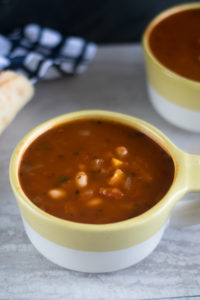 This Easy Tomato and White Bean Soup has a secret ingredient—marinara sauce! Use your favorite marinara sauce. The best part about this soup is that most of the ingredients are pantry staples. #soup #healthy #recipe #healthyrecipes #glutenfree #vegan #soup