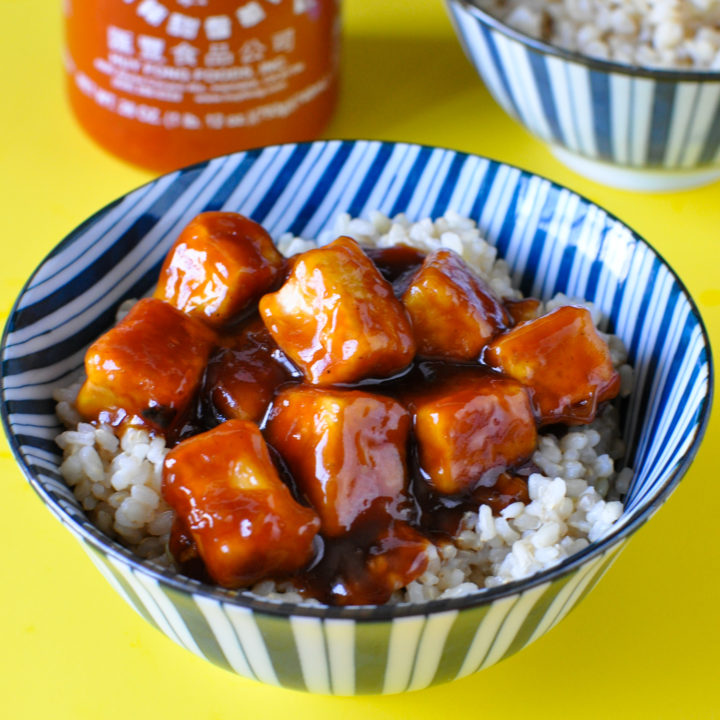 Skip the take-out and make this slightly sweet and spicy Sriracha Tofu at home!