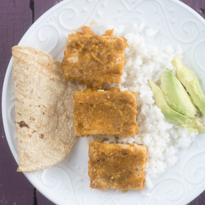 Tomatillo Chipotle Tofu served with rice, tortillas, and rice is a delicious vegan meal!