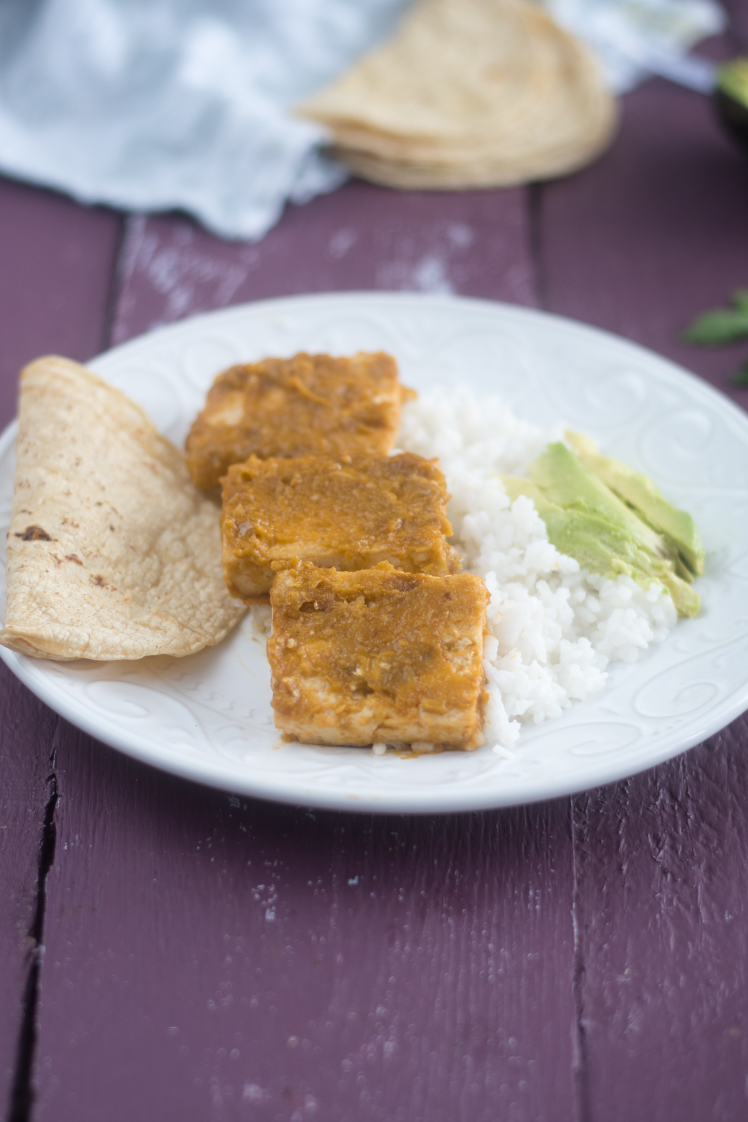 Tomatillo Chipotle Tofu is a flavorful plant-based entree. Tofu is simmered in a sweet and spicy sauce. #vegan #tofu #recipes #Mexican