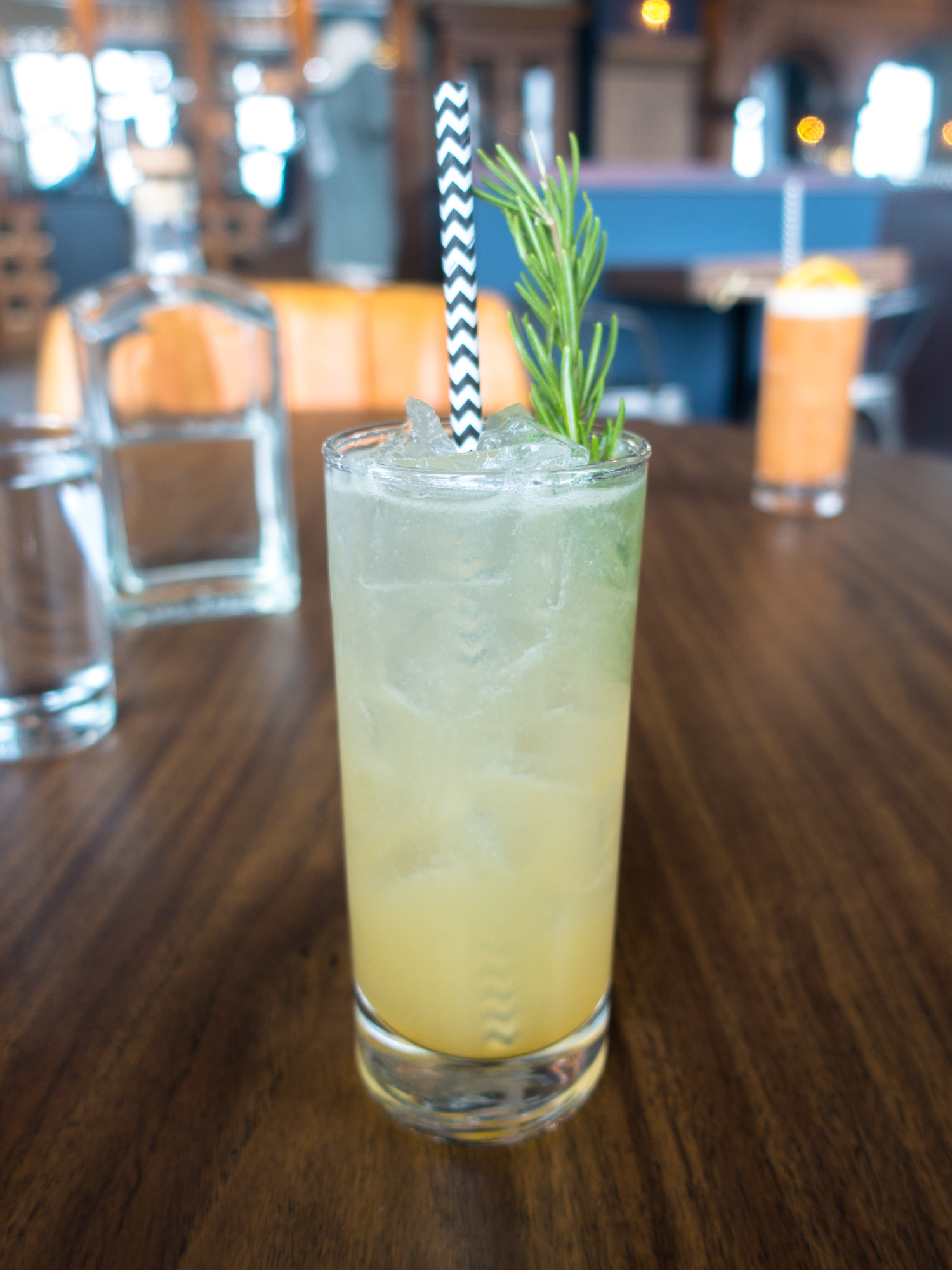 Railway Gunner—a unique gin cocktail with rosemary syrup, lime juice, and apricot jam.