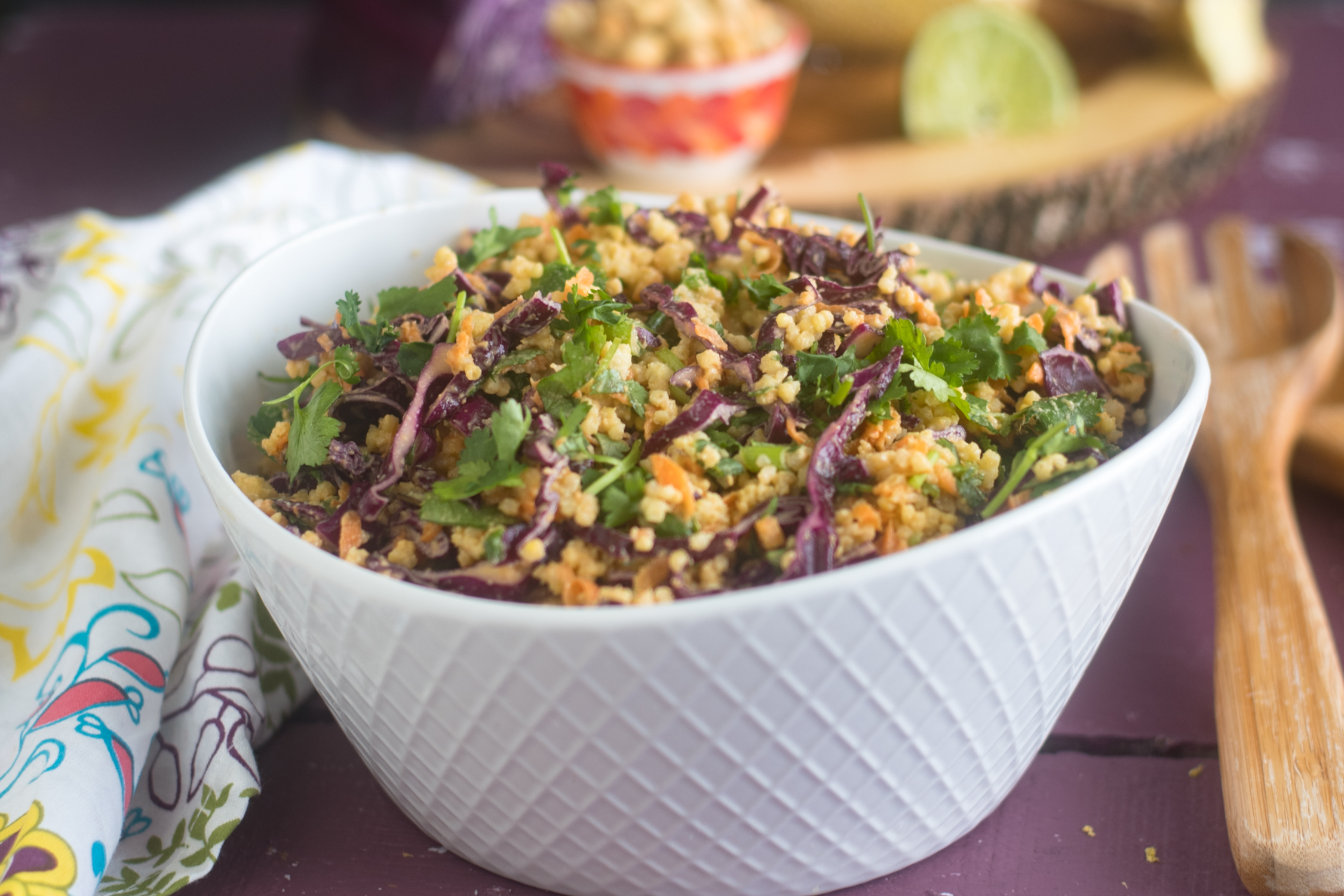 The base of this Vegan Thai Peanut Millet Salad is cooled millet, shredded red cabbage, carrots, green onions, and cilantro. The millet bulks up the salad, adding fiber, B-complex vitamins, as well as several essential amino acids.