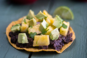 Black bean tostadas with pineapple salsa are perfect for a quick and easy meal. #vegan #recipe #easyrecipes #glutenfree #avocado #Mexican #vegetarian #healthy #healthyrecipes