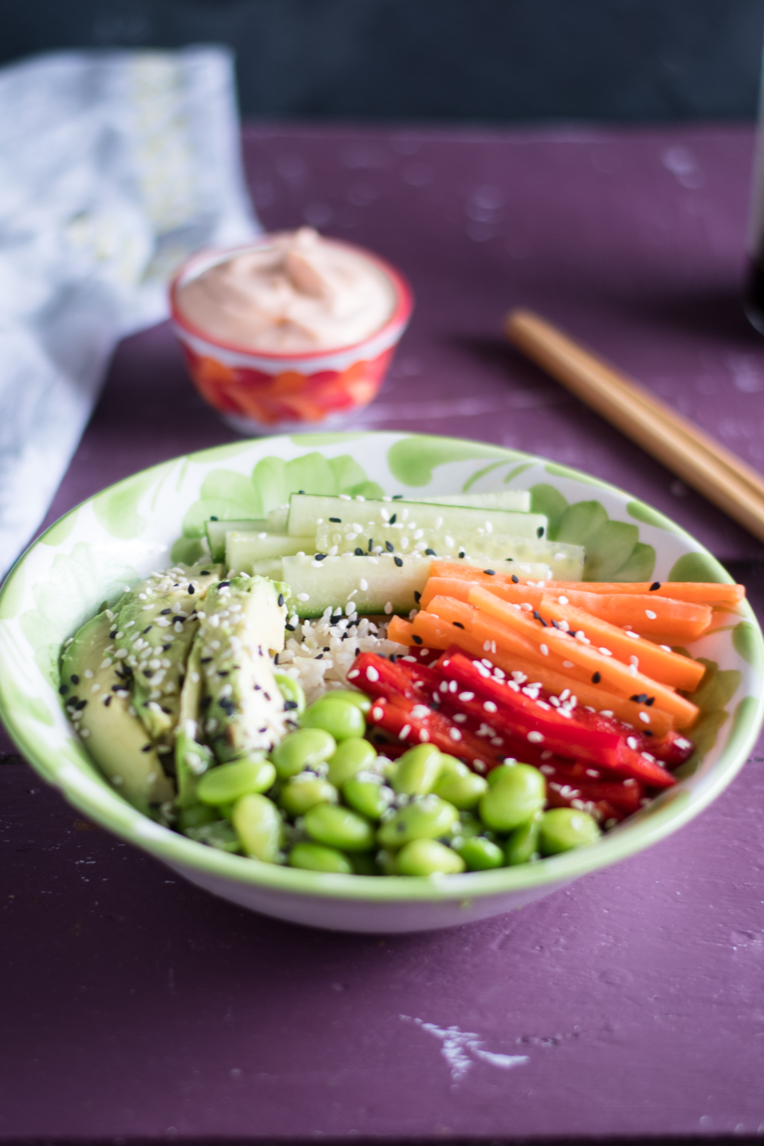 Vegan Sushi Bowl served over green tea infused rice. Topped with a variety of vegetables. #vegan #rice #tea #vegan #recipes #glutenfree #healthy