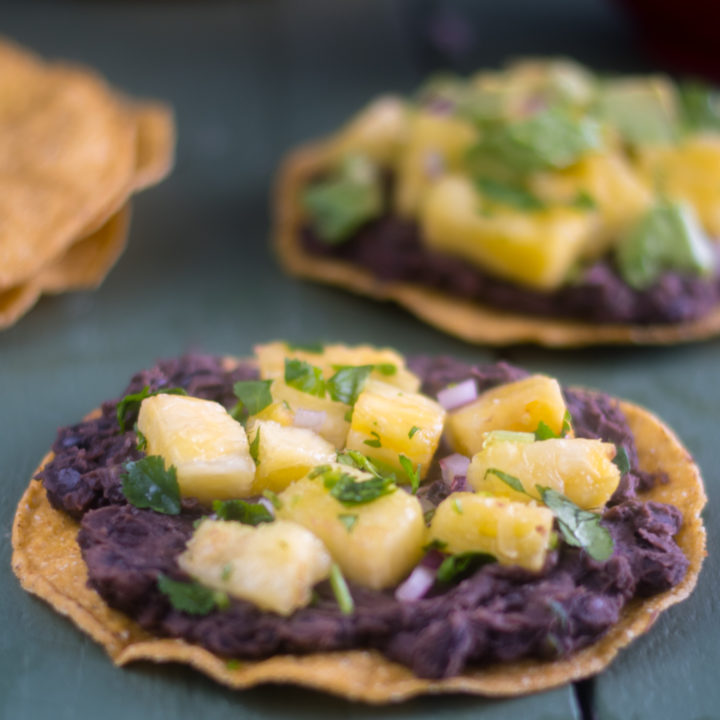Black Bean Tostadas topped with Pineapple Salsa are a quick and easy meal. #vegan #Mexican #easyrecipes #tostadas #taconight #Mexican
