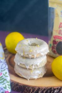Baked Vegan Lemon Poppy Seed Donuts topped with a lemon glaze. #vegan #lemon #donuts #breakfast #donuts #dessert
