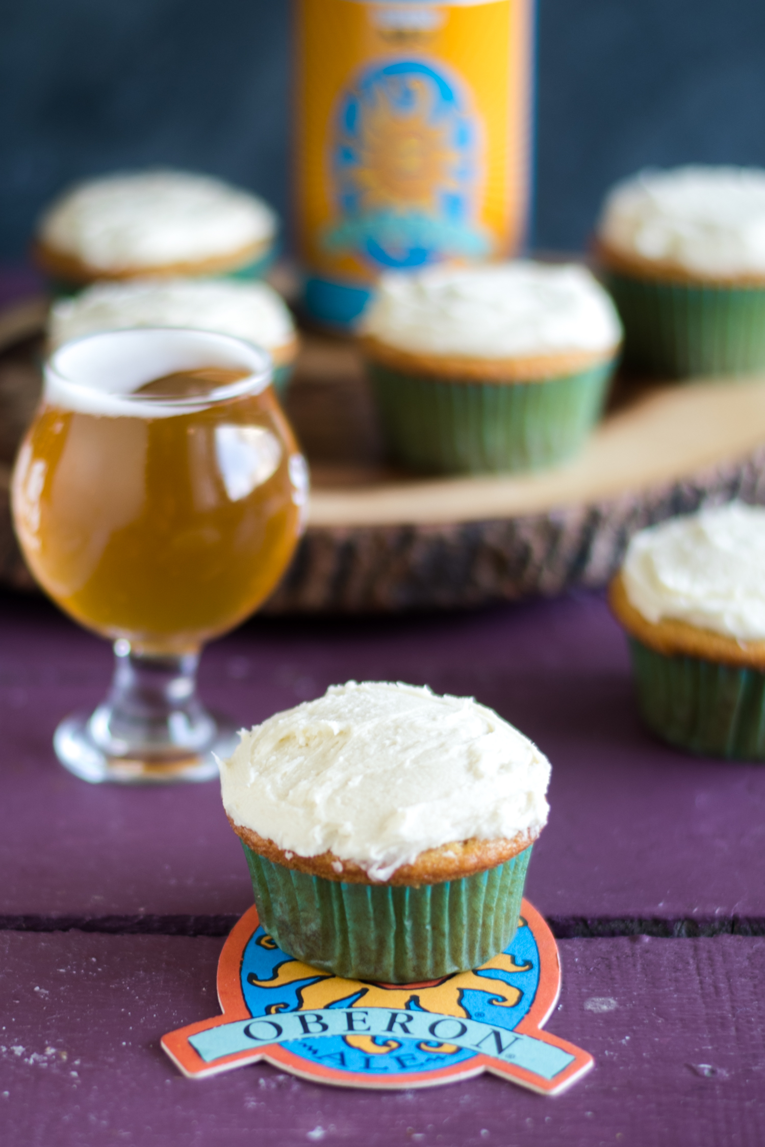 Cupcakes made with Bell's Oberon wheat ale. These cupcakes are light, tender and bursting with bright citrus flavor. #beer #dessert #cupcakes #bells #craftbeer #food