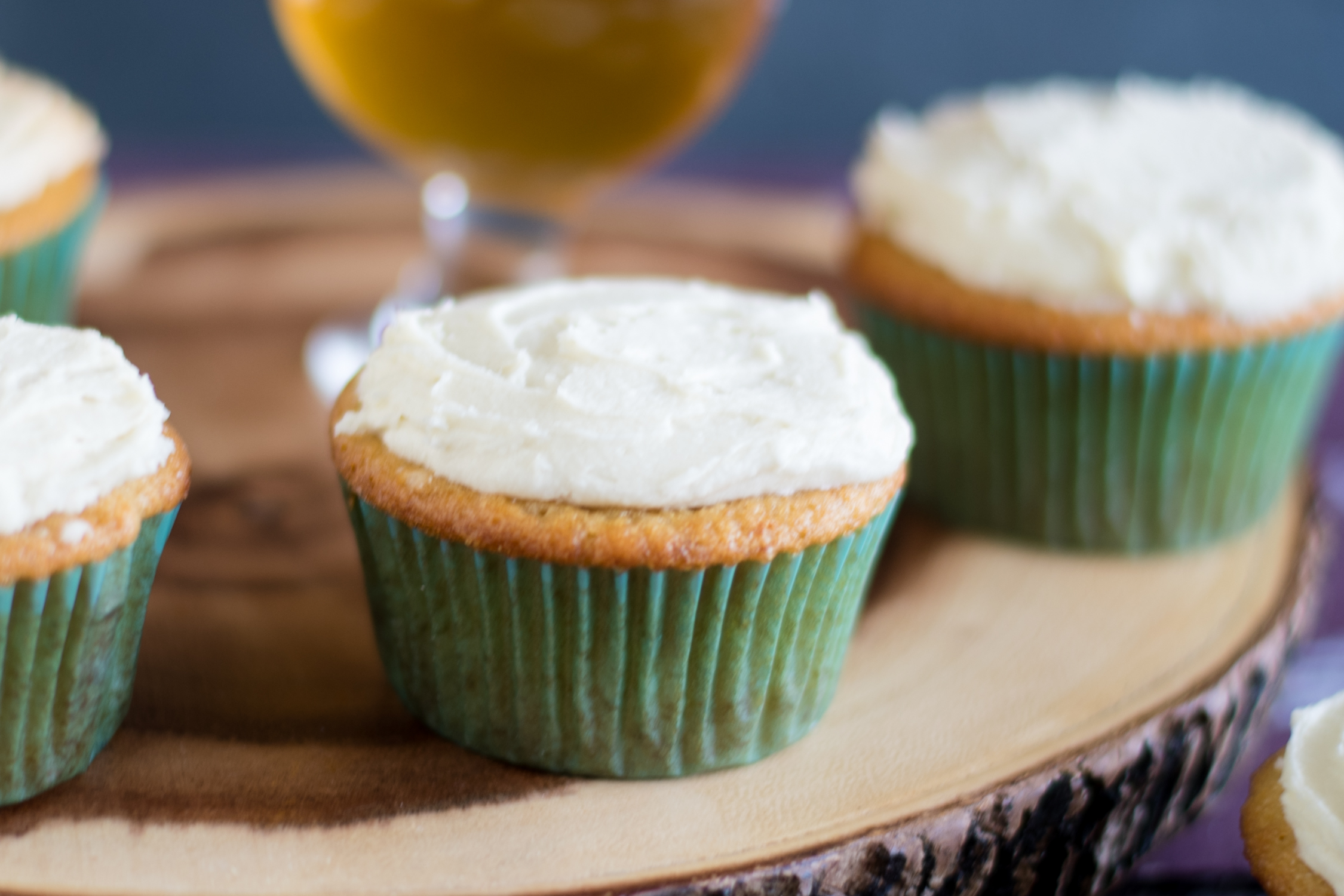 Oberon Orange Cupcakes are made with lots of fresh orange juice and zest, bringing out the citrus notes of the Oberon wheat ale. #beer #cupcakes #dessert #vegan #orange #spring #easter #summer #dessert