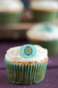 Oberon Orange Cupcakes topped with a coconut oil frosting.