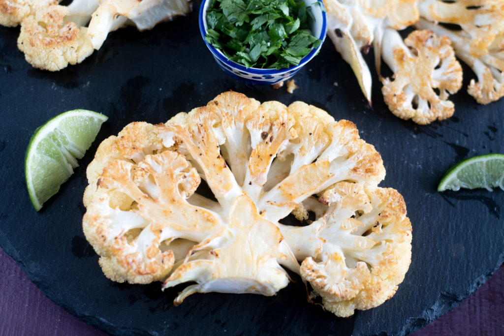 These Chipotle Roasted Cauliflower Steaks are perfect if you are looking for healthy plant-based main entree.