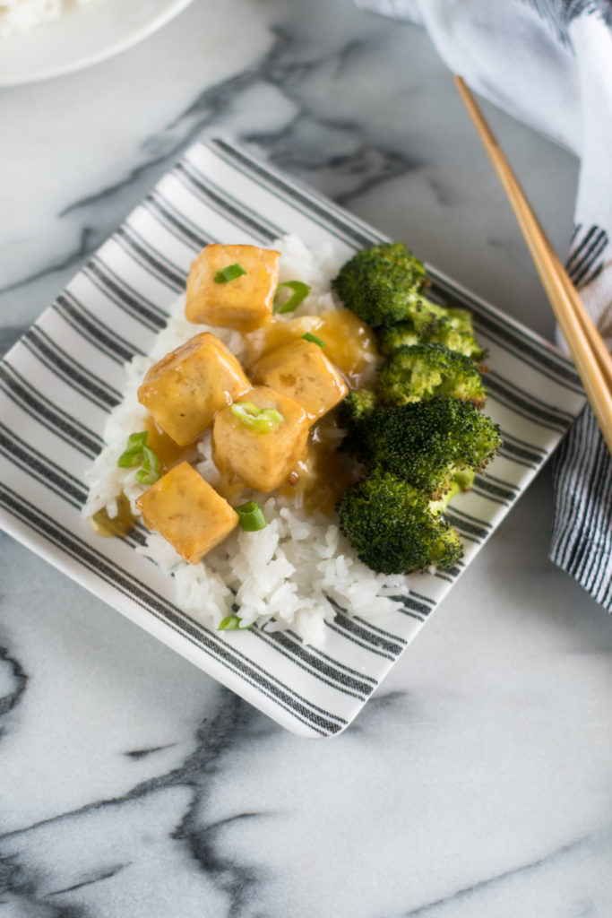 This easy and simple recipe for Vegan Orange Tofu is inspired by the popular Chinese dish. This vegan version is just as good as the original! This recipe is also gluten-free and oil-free #vegan #tofu #recipes