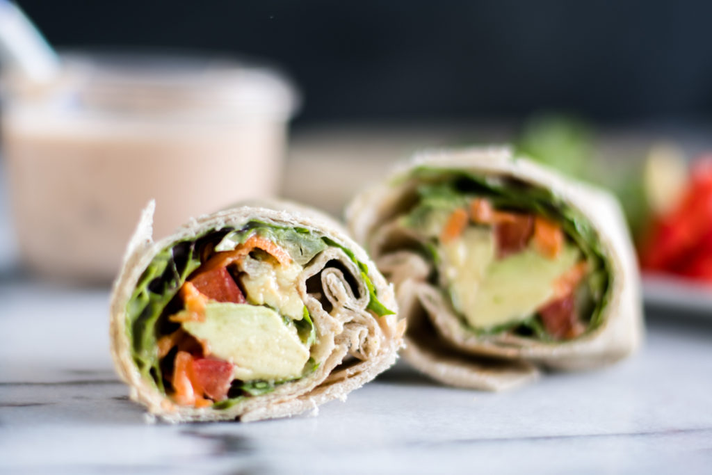Looking for a quick and easy lunch recipe? You are going to love how easy it is to makes these Easy Vegan Veggie Wraps with Chipotle Dressing.