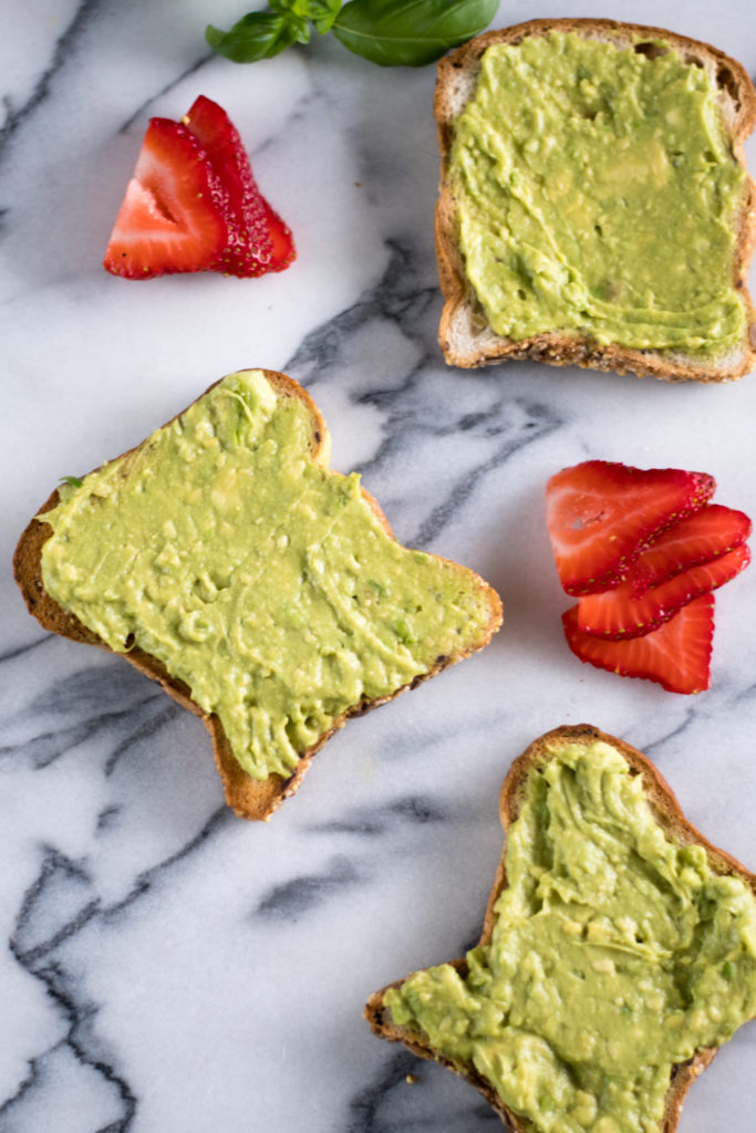 This Strawberry Avocado Toast is perfect for any spring brunch! Sliced strawberries, fresh basil, and balsamic vinegar take this toast to the next level!