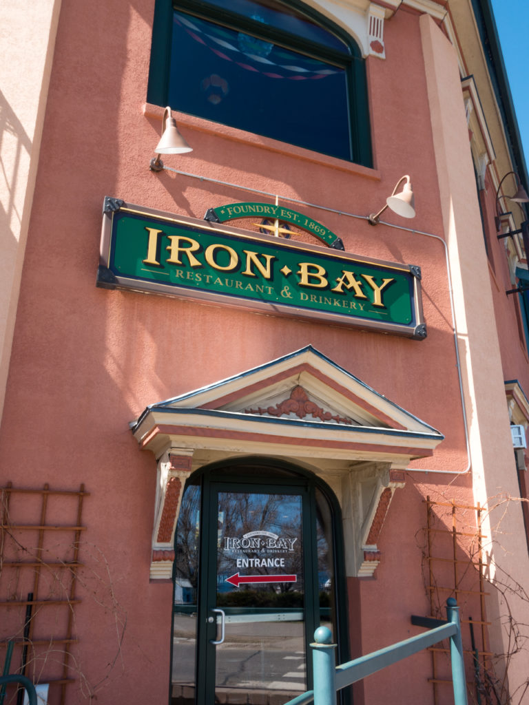 Located along the Iron Bay Harbor in downtown Marquette, Iron Bay is a historical landmark. The historic building originally housed the Iron Bay Foundry which was built in 1872. This building was the heart of the city and the lifeblood of the mining industry.  #Michigan #Marquette #UpperPennisula #travel