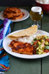 Looking to spice up basic tofu? Chipotles peppers add a spicy kick to plain tofu. Baked Chipotle Tofu is perfect for a main entree, used as a taco filling or on a sandwich! #tofu #recipe #vegan #vegetarian #easyrecipes #plantbased #veganmexican #Mexican