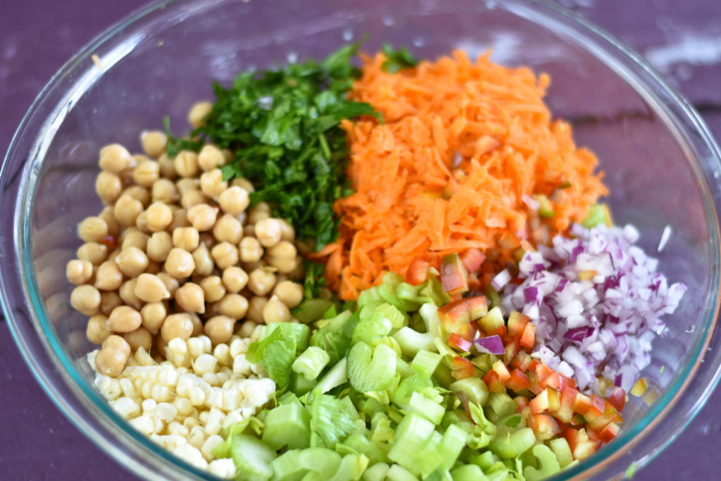 Looking for a healthy plant-based salad? This Chickpea Celery Salad is packed with healthy nutrition. If you are tired of boring salads, give this one a try! #salad #healthyfood #plantbased #celery #chickpea #protein #Carrots #glutenfree #healthyrecipes #veganrecipes