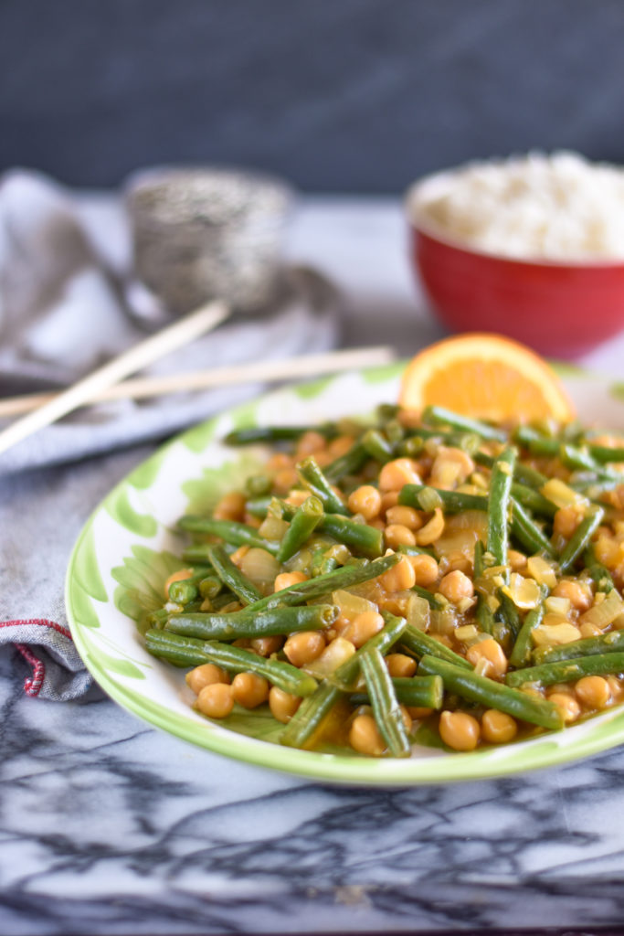 Looking for a quick and easy dinner recipe? Orange Chickpea Green Bean Stir Fry takes less than 30 minutes to make. Perfect for a busy weeknight meal!  #stiryfry #vegetarian #dinner #recipes #glutenfree #vegan #food #healthyrecipes #vegetarian #entree