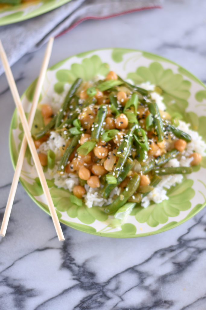 Green Bean Chickpea with Orange Sauce is a healthy, plant-based dinner entree. Skip the takeout and make this healthy stir fry at home! #vegan #recipes #greenbeans #healthy #food #recipes #vegetarian