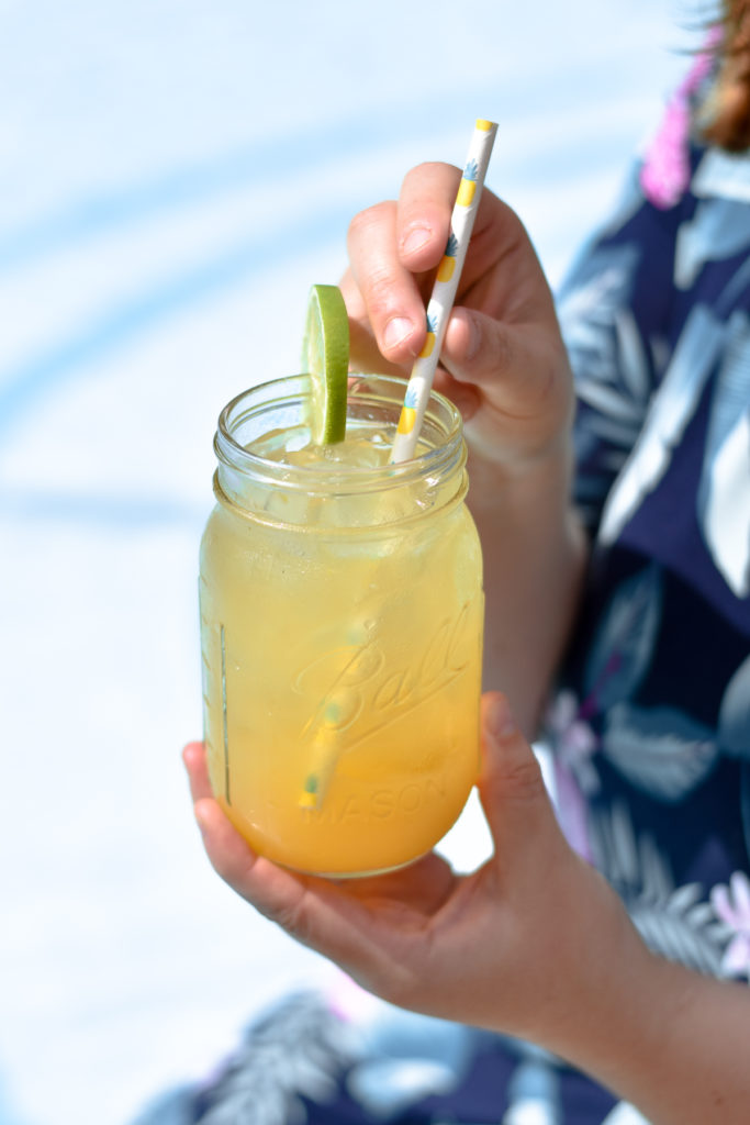Tropical Fruit Gin Punch is light, refreshing, and perfectly balanced . It is the perfect drink to sip on by the pool. #drink #fruit #punch #cocktail #beverage #pineapple #guava #orange