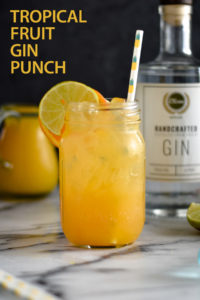 Celebrate the end of summer with this refreshing Tropical Fruit Gin Punch! It's light, refreshing, and perfectly balanced. #vegan #drink #beverage #orange #pineapple #gin #cocktail