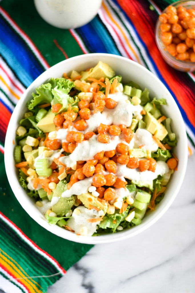 Salads don't have to be boring! This Buffalo Chickpea Salad is packed full of flavor. It is a hearty and filling salad that's easy to make. #salad #vegan #buffalo #lunch #recipes #easyrecipes