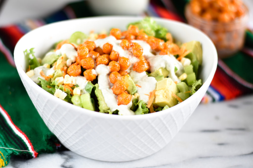 Buffalo Chickpea Salad with ranch dressing is a hearty, filling salad that is packed full of flavor. #salad #buffalo #vegan #recipes