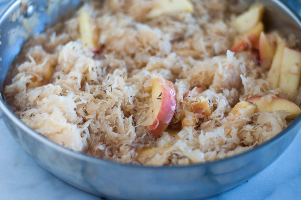 This Vegan Sauerkraut and Bratwurst Casserole is a cozy casserole that is perfect for the cooler weather. It is loaded with vegan bratwurst sausages, onion, apples, and lots of sauerkraut!  #vegan #apples #sauerkraut #recipes #food