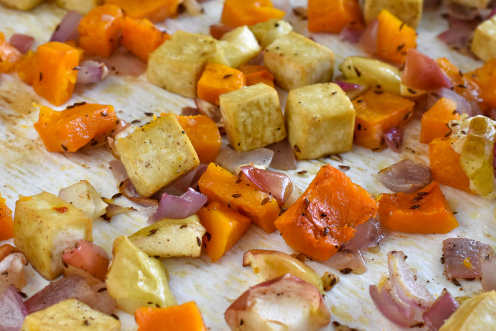 Looking for an easy sheet pan dinner? This fall focused recipe features Roasted Butternut Squash, Apples, and Tofu topped with an apple cider gravy.