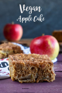 Curl up on the couch in a warm, cozy sweater, cup a coffee, and slice of this sweet, but not overly sweet cake. #vegan #apples #cake #dessert #veganrecipes #baking #fallfood #holiday #dessert