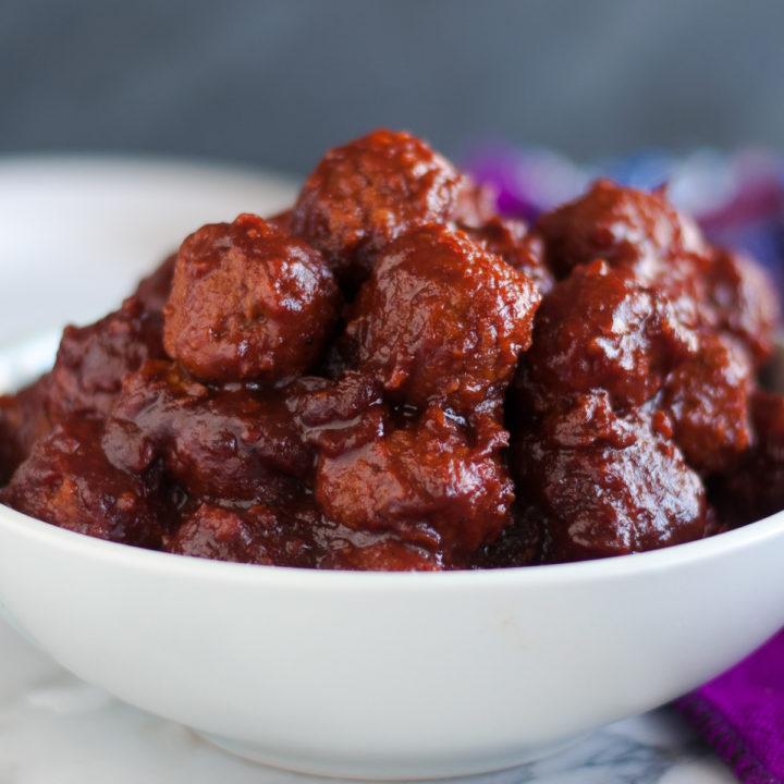 Vegan Slow Cooker Meatballs cooked in a cranberry BBQ sauce. #vegan #slowcooker #crockpot #entertaining #Christmas #holiday #easyrecipes #recipes