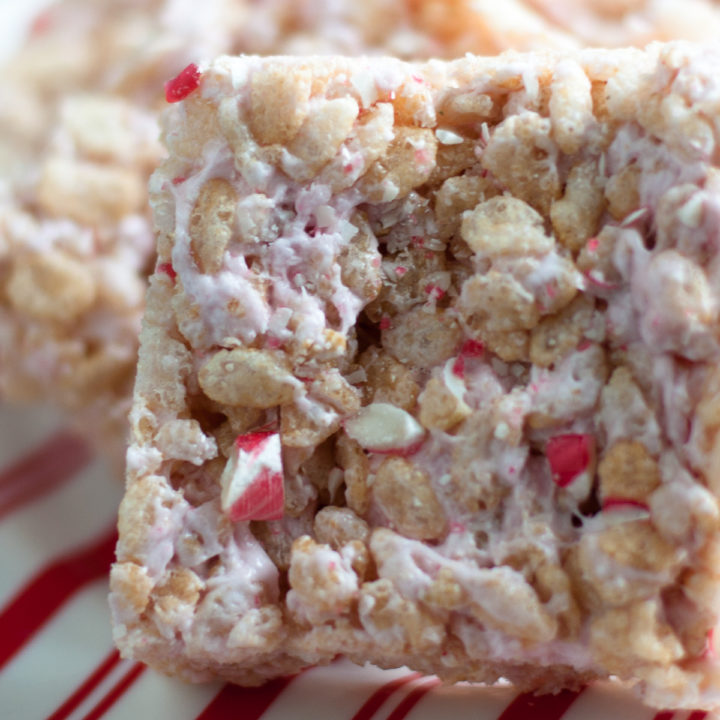 A festive spin on the classic rice crispy treat. Peppermint marshmallows add a pop of holiday cheer to the treats! #desserts #Christmas #food #holiday #peppermint #holidayfood #vegan