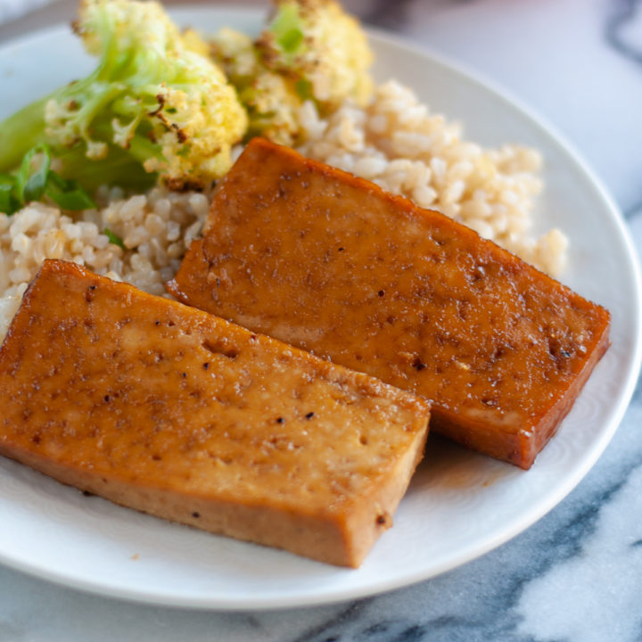 Slices of tofu are baked in a sweet and tangy Asian ginger glaze. This glaze is a little sweet and sticky. #Tofu #recipes #vegetarian #easyrecipes #veganrecipes #food