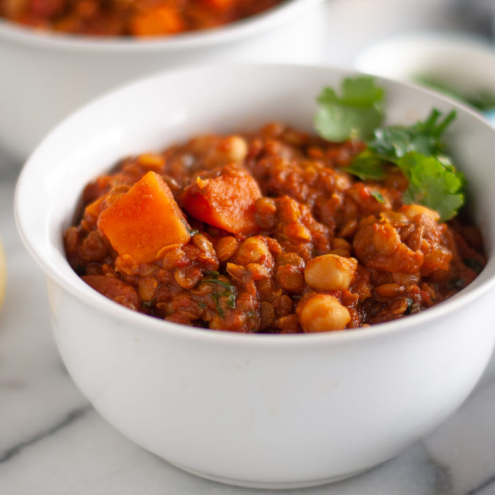 x Sweet Potato Lentil and Chickpea Stew with warming spices is a protein packed stew perfect on a chilly night. It is packed full of plant-based protein and budget-friendly! #vegan #recipes #food #dinner #entree #stew #sweetpotato #chickpeas