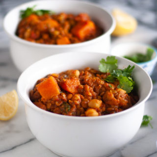 Sweet Potato Lentil and Chickpea Stew with warming spices is a protein packed stew perfect on a chilly night. #vegan #stew #recipes #vegetarian #healthy #sweetpotato #chickpea #lentils #dinner