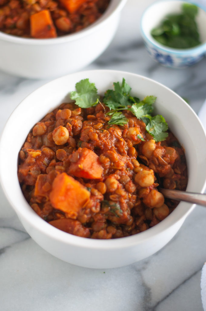 Sweet Potato Lentil and Chickpea Stew with warming spices is a protein packed stew perfect on a chilly night. #vegan #recipes #stew #food #sweetpotatoes #chickpeas #lentil #vegetarian