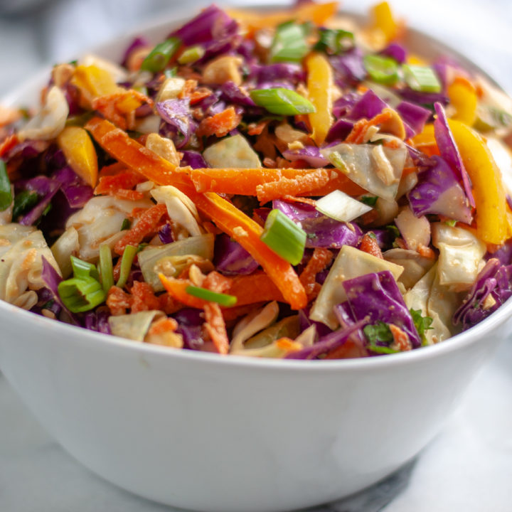 This Asian inspired chopped vegetable salad is tossed in a creamy peanut dressing. #salad #vegan #Asian #recipes #healthy