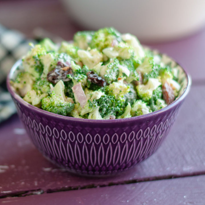This creamy, savory, crunchy, and delicious Vegan Broccoli Salad with Dried Cherries is the perfect potluck dish! #vegan #salad #broccoli #plantbased #wholefoods